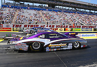 Mar 28, 2014; Las Vegas, NV, USA; NHRA pro stock driver Vincent Nobile (near lane) races alongside Jason Line during qualifying for the Summitracing.com Nationals at The Strip at Las Vegas Motor Speedway. Mandatory Credit: Mark J. Rebilas-