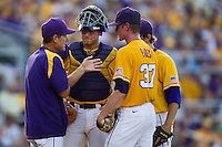 LSU Tigers catcher Ty Ross #26 at the mound during the NCAA Super Regional baseball game against Stony Brook on June 10, 2012 at Alex Box Stadium in Baton Rouge, Louisiana. Stony Brook defeated LSU 7-2 to advance to the College World Series. (Andrew Woolley/Four Seam Images)