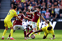 3rd October 2021;   City of London Stadium, London, England; EPL Premier League football, West Ham versus Brentford; Declan Rice of West Ham United competes for the ball with Ivan Toney of Brentford