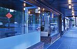 Sidewalk Scene.  Georgetown neighborhood, Seattle, WA.  Red brick, arched glass, empty lighted hallway, concrete stairs.