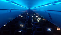 """""""Redeye Flight in Blue"""" by Art Harman. Somewhere over America on a transcontinental flight, as passengers slumbered and the deep blue cabin lights added an ethereal glow at 500 mph."""