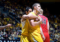 Jorge Gutierrez of California hugs Harper Kamp of California after Kamp made a huge play during the game against Arizona at Haas Pavilion in Berkeley, California on February 2nd, 2012.  Arizona defeated California, 78-74.