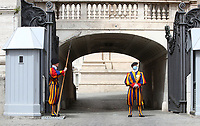 A Swiss Guard wearing a face mask stands guard by St. Peter's Basilica as it reopens on May 18, 2020 at the Vatican. Italy is slowly lifting sanitary restrictions after a two-month coronavirus lockdown.<br /> UPDATE IMAGES PRESS/Isabella Bonotto<br /> <br /> STRICTLY ONLY FOR EDITORIAL USE