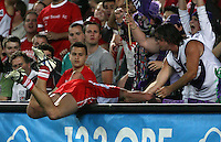 AFL preliminary final Sydney Swans v Fremantle Dockers at Telstra stadium, Sydney 22/09/06. Luke Ablett almost disappears over the boundary fence. - pic by Trevor Collens.