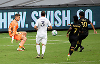 LOS ANGELES, CA - OCTOBER 25: Carlos Vela #10 the Los Angeles Football Club scores a goal off Jonathan Klinsmann #33 of the Los Angeles Galaxy during a game between Los Angeles Galaxy and Los Angeles FC at Banc of California Stadium on October 25, 2020 in Los Angeles, California.