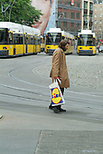 A homeless Berlin man carries a Lidl bag in Hackescher Markt
