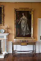 Portrait of Henrietta Maria, Queen consort to Charles I, hangs beside a later portrait of her son Charles II in the dining room