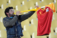 A Spain fan blows on a large horn. Spain defeated New Zealand 5-0 during the FIFA Conferderations Cups at Royal Bafokeng Stadium, in Rustenburg South Africa on June 14, 2009.