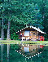 Cabin and reflection in pond at Bear Creek Lodge. Hope, Alaska