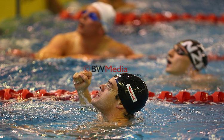 Cameron Simpson, NZL, celebrates winning the 50m Free. Mayfair Pools Oceania Champs, Westwave Aquatic Centre, Henderson, New Zealand, New Zealand. Friday 23 May 2014. Photo: Simon Watts/www.bwmedia.co.nz
