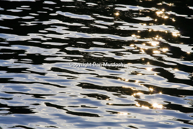 sunlight reflected in rippling water