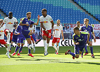 16th May 2020, Red Bull Arena, Leipzig, Germany; Bundesliga football, Leipzig versus FC Freiburg;  Manuel Gulde SCF scores for 0-1 as he is challenged by Christopher Nkunku RBL