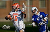Garett Ince (15) of Virginia makes his way past CJ Costabile (9) of Duke during the ACC men's lacrosse tournament semifinals in College Park, MD.  Virginia defeated Duke, 16-12.