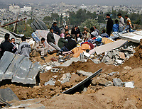 "Palestinains setting on their destroyed house  after isreal withdrawal from gaza strip.March.03.2008.""phto by Fady Adwan"""