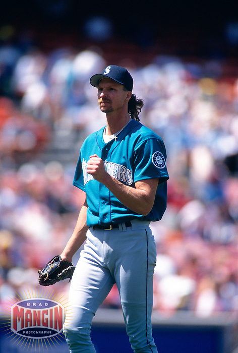 OAKLAND, CA - Randy Johnson of the Seattle Mariners pitches during a game against the Oakland Athletics at the Oakland Coliseum in Oakland, California in 1994.  Photo by Brad Mangin
