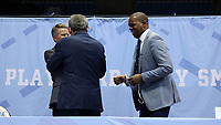 CHAPEL HILL, NC - APRIL 6: UNC men's basketball head coach Hubert Davis shares a laugh with Chancellor Kevin Guskiewicz and Athletic Director Bubba Cunningham after his introductory press conference at Dean E. Smith Center on April 6, 2021 in Chapel Hill, North Carolina.