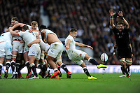 Danny Care of England send up a box kick as Richie McCaw of New Zealand attempts to block during the QBE International match between England and New Zealand at Twickenham Stadium on Saturday 8th November 2014 (Photo by Rob Munro)