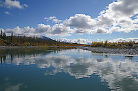 Clouds are reflected in the Sheenjek River, which flows south from Alaska's Brooks Range into the Yukon River Flats, in the Arctic National Wildlife Refuge in late August.