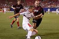 The Chicago Fire's Logan Pause tries to save a ball at the end line as the  MetroStars' Tim Regan and Eddie Gaven defend. The Chicago Fire played the NY/NJ MetroStars to a one all tie at Giant's Stadium, East Rutherford, NJ, on May 15, 2004.