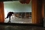 Women is cleaning a village club in an abandoned village. It is used now only 2-3 times in a year because nowdays people go there just in summer to spend their holidays