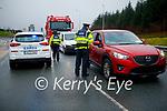 Garda Ger O'Sullivan and Garda Aisling Connor at the Garda checkpoint in Castleisland on Tuesday.