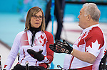 Sochi, RUSSIA - Mar 13 2014 - Sonja Gaudet, and Jim Armstrong as Canada takes on Slovakia in round robin play at the 2014 Paralympic Winter Games in Sochi, Russia.  (Photo: Matthew Murnaghan/Canadian Paralympic Committee)