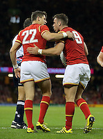 Pictured: Gareth Davies of Wales (R) celebrates his try with team mate Lloyd Williams (L) Sunday 20 September 2015<br /> Re: Rugby World Cup 2015, Wales v Uruguay at the Millennium, Stadium, Wales, UK<br /> <br /> rwc, rugby, world, cup, england, 2015, wales, v, uruguay, sports, welsh, uruguaian, try, players