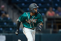 Yoney Frajardo (32) of the Greensboro Grasshoppers hustles down the first base line against the Winston-Salem Dash at Truist Stadium on August 11, 2021 in Winston-Salem, North Carolina. (Brian Westerholt/Four Seam Images)