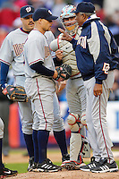 3 April 2006: Frank Robinson, Manager of the Washington Nationals (right, in jacket), gives instructions to pitcher Joey Eischen as catcher Brian Schneider and first baseman Nick Johnson (leftmost) look on during Opening Day play against the New York Mets at Shea Stadium, in Flushing, New York. The Mets defeated the Nationals 3-2 to lead off the 2006 MLB season...Mandatory Photo Credit: Ed Wolfstein Photo..