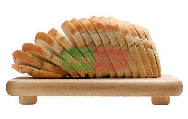 cutting board with sliced loaf of white bread on shadowless white background