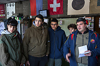 """Switzerland. Canton Ticino. Cureglia is a municipality in the district of Lugano. """"Tiratori del Gaggio"""" society. Shooting range. Young shooters' course. The courses, whose organisation is delegated by the Federal Department of Defence, Civil Protection and Sport to the various local shooting societies, are open to young swiss people, boys and girls, from 15 to 20 years old. Girls and boys learn how to handle and fire with the assault rifle SG 550, also called Fass 90, used by the Swiss Army. (Left to right) Sheryl, Matteo, Gabriel, Tommaso listen to the speech by Paolo Grassi, responsible for the security during the course. The SG 550 is an assault rifle manufactured by Swiss Arms AG (formerly Schweizerische Industrie Gesellschaft) of Neuhausen, Switzerland. """"SG"""" is an abbreviation for Sturmgewehr, or """"assault rifle"""". The rifle is known as the Fass 90 or Stgw 90. An assault rifle is a selective-fire rifle that uses an intermediate cartridge and a detachable magazine. 9.02.2019 © 2019 Didier Ruef"""