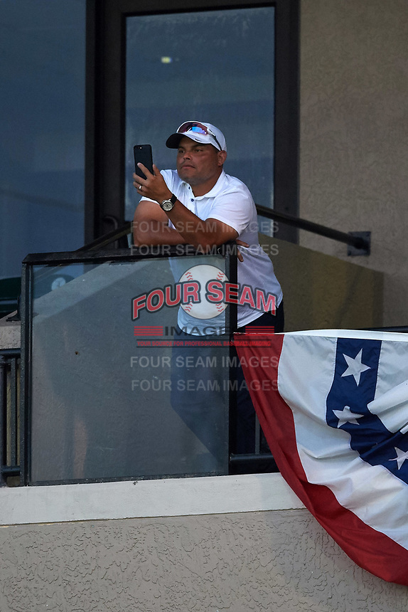 Hall of Fame catcher Ivan Rodriguez uses his cell phone to record his son Dereck pitching in the third inning of the Florida State League All-Star Game on June 17, 2017 at Joker Marchant Stadium in Lakeland, Florida.  FSL North All-Stars  defeated the FSL South All-Stars  5-2.  (Mike Janes/Four Seam Images)