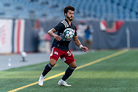 FOXBOROUGH, MA - JULY 25: USL League One (United Soccer League) match. Ryan Spaulding #34 of New England Revolution II chest trap during a game between Union Omaha and New England Revolution II at Gillette Stadium on July 25, 2020 in Foxborough, Massachusetts.