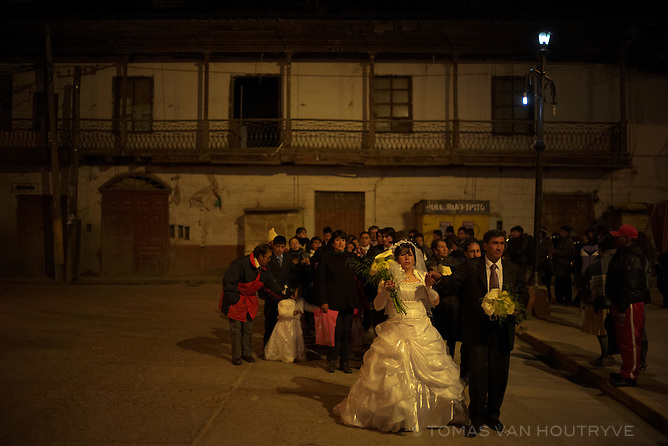 Hector Amilcar Jullca Zanabria and Maria Luz Pacahuala Inga parade through the historic central square of Cerro de Pasco, Peru after their wedding in the city's main Catholic church in the Chaupimarca neighborhood. The church and surrounding historic square are slated for destruction to expand open-pit mining operations.