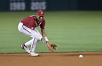 Arkansas infielder Jalen Battles (4) catches, Saturday, June 5, 2021 during the eighth inning in the second game of the NCAA Fayetteville Regional at Baum-Walker Stadium in Fayetteville. Check out nwaonline.com/210606Daily/ for today's photo gallery. <br /> (NWA Democrat-Gazette/Charlie Kaijo)