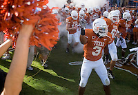 24 November 2006: Texas back Chris Ogbonnaya (#3) runs out of the smoke to take the field before the Longhorns game against the Texas A&M University Aggies at Darrell K Royal Memorial Field in Austin, TX.