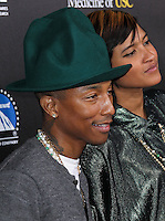 HOLLYWOOD, LOS ANGELES, CA, USA - MARCH 20: Pharrell Williams, Helen Lasichanh at the 2nd Annual Rebels With A Cause Gala Honoring Larry Ellison held at Paramount Studios on March 20, 2014 in Hollywood, Los Angeles, California, United States. (Photo by Xavier Collin/Celebrity Monitor)