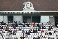Spectators look on from the pavilion during Surrey CCC vs Essex CCC, LV Insurance County Championship Division 2 Cricket at the Kia Oval on 12th September 2021