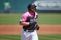 Jake Burger (9) of the Charlotte Knights jogs towards home plate after hitting a 2-run home run against the Gwinnett Stripers at Truist Field on May 9, 2021 in Charlotte, North Carolina. (Brian Westerholt/Four Seam Images)