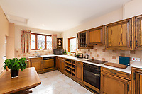 BNPS.co.uk (01202 558833)<br /> Pic: Savills/BNPS<br /> <br /> Pictured: The kitchen with wooden furniture.<br /> <br /> A historic thatched home where Cromwell's army stayed during the English Civil War is on the market for £1.6m.<br /> <br /> The Barracks, so-named for its links with Cromwell more than 370 years ago, has spectacular country views and is in one of Cheshire's most popular areas.<br /> <br /> The five-bedroom property just outside the picturesque village of Bunbury is a far cry from how it would have looked in Cromwell's time, having been extended over the years.<br /> <br /> It was used in the 17th century by Cromwell's armies during the siege of Beeston Castle - two miles away. The castle's location made it valuable to both the royalists and parliamentarians.