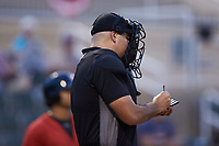 Home plate umpire Thomas O'Neil makes notes during the South Atlantic League game between the Hagerstown Suns and the Kannapolis Intimidators at Kannapolis Intimidators Stadium on August 27, 2019 in Kannapolis, North Carolina. The Intimidators defeated the Suns 5-4. (Brian Westerholt/Four Seam Images)