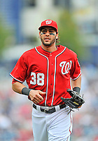 25 September 2011: Washington Nationals outfielder Michael Morse trots back to the dugout during a game against the Atlanta Braves at Nationals Park in Washington, DC. The Nationals shut out the Braves 3-0 to take the rubber match third game of their 3-game series - the Nationals' final home game for the 2011 season. Mandatory Credit: Ed Wolfstein Photo
