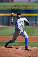 Glendale Desert Dogs pitcher Jharel Cotton (37) delivers a pitch during an Arizona Fall League game against the Mesa Solar Sox on October 14, 2015 at Sloan Park in Mesa, Arizona.  Glendale defeated Mesa 7-6.  (Mike Janes/Four Seam Images)