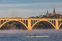 Early Morning Rowers in Skiff on Potomac River, Key Bridge and Georgetown University in Background, Washington DC, USA.
