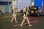 """© Joel Goodman - 07973 332324 . 17/12/2016 . Manchester , UK . Two women cross Withy Grove . Revellers out in Manchester City Centre overnight during """" Mad Friday """" , named for being one of the busiest nights of the year for the emergency services in the UK . Photo credit : Joel Goodman"""