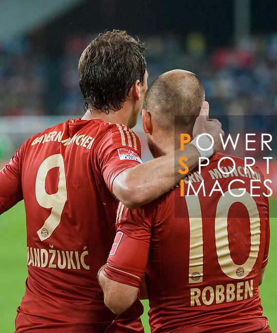 Arjen Robben of Bayern Munich is congratulated by Mario Mandzukic after scoring during a friendly match against VfL Wolfsburg as part of the Audi Football Summit 2012 on July 26, 2012 at the Guangdong Olympic Sports Center in Guangzhou, China. Photo by Victor Fraile / The Power of Sport Images