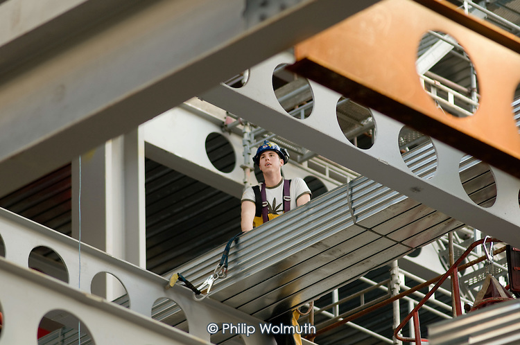 A steel-rigger wearing a harness and a helmet on the site of a new office development by British Land PLC in the City of London.