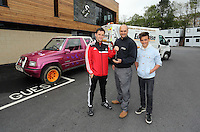 Pictured L-R: Team physiotherapist Richie Buchanan hands over the keys to Leigh Evans for the Suzuki Samurai at the Landore Training Ground. Saturday 10 May 2014<br />