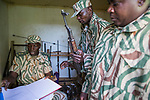 Anti-poaching scout receiving rifle from armory before deployment, Kafue National Park, Zambia