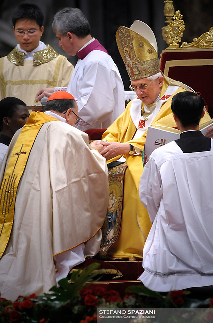 Pope Benedict XVI (L) gives his cardinal ring to Brazilian Raymundo Damasceno Assis (R) during the Eucharistic celebration with the new cardinals on November 21, 2010 at St Peter's basilica at The Vatican. 24 Roman Catholic prelates joined the day before the Vatican's College of Cardinals, the elite body that advises the pontiff and elects his successor upon his death